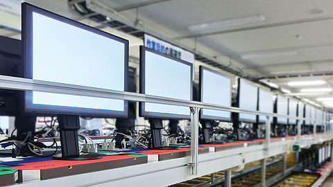 Monitor on conveyor belt during the aging process